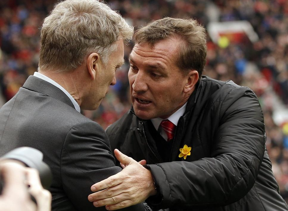 """Manchester United's manager David Moyes (L) greets his Liverpool counterpart Brendan Rodgers before their English Premier League soccer match at Old Trafford in Manchester, northern England, March 16, 2014. REUTERS/Phil Noble (BRITAIN - Tags: SPORT SOCCER) FOR EDITORIAL USE ONLY. NOT FOR SALE FOR MARKETING OR ADVERTISING CAMPAIGNS. NO USE WITH UNAUTHORIZED AUDIO, VIDEO, DATA, FIXTURE LISTS, CLUB/LEAGUE LOGOS OR """"LIVE"""" SERVICES. ONLINE IN-MATCH USE LIMITED TO 45 IMAGES, NO VIDEO EMULATION. NO USE IN BETTING, GAMES OR SINGLE CLUB/LEAGUE/PLAYER PUBLICATIONS Phil Noble/Reuters"""