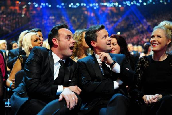 Anthony McPartlin and Declan Donnelly watch a video before they are presented with the Landmark Award during the 2014 National Television Awards at the O2 Arena, London. PRESS ASSOCIATION Photo. Picture date: Wednesday January 22, 2014. See PA story SHOWBIZ Awards. Photo credit should read: Ian West/PA Wire